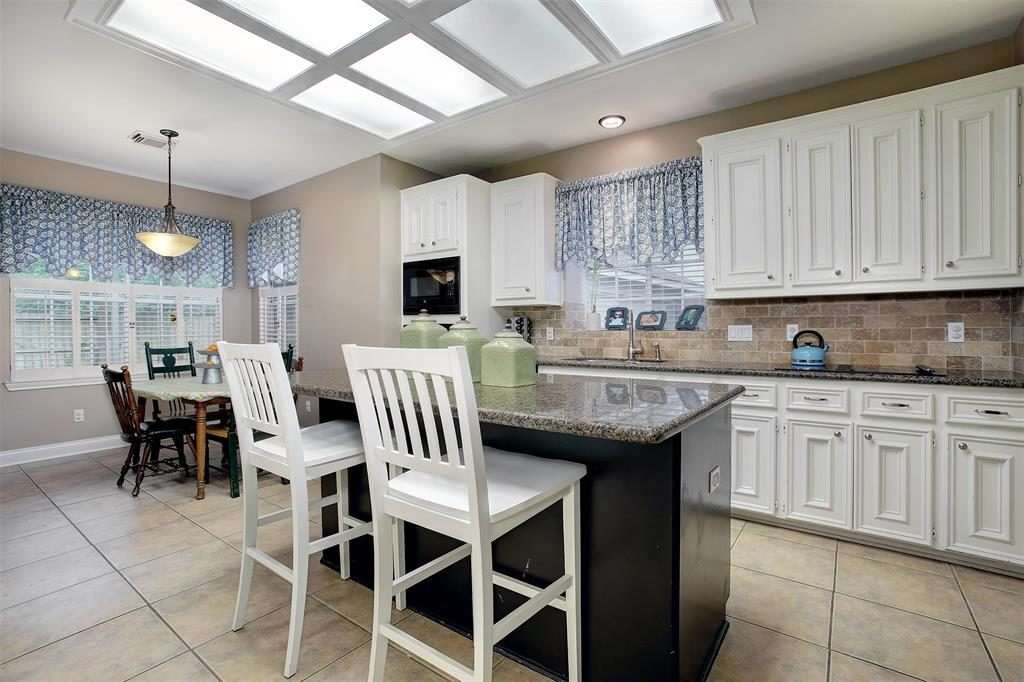 kitchen with island opens to breakfast area