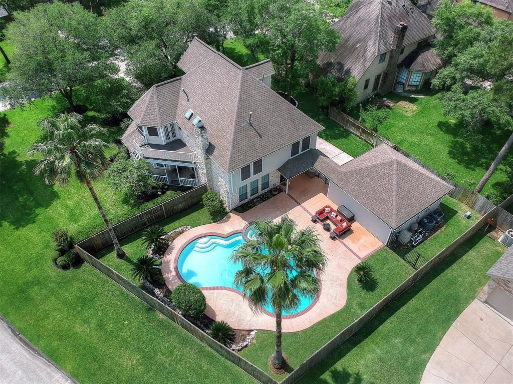 aerial view of home and backyard oasis