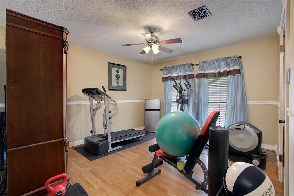 bedroom used as home gym by bathroom