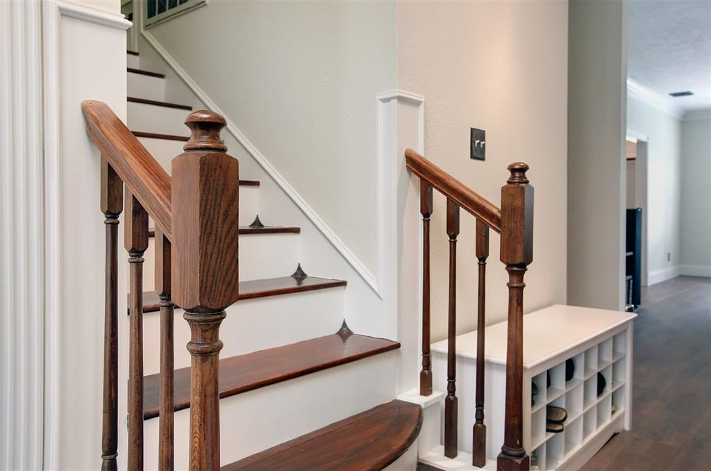 natural wood stairs and railings