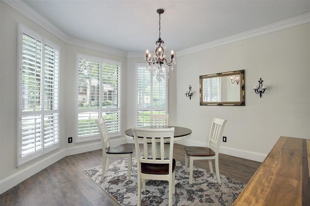 dining room with chandelier and large windows with view
