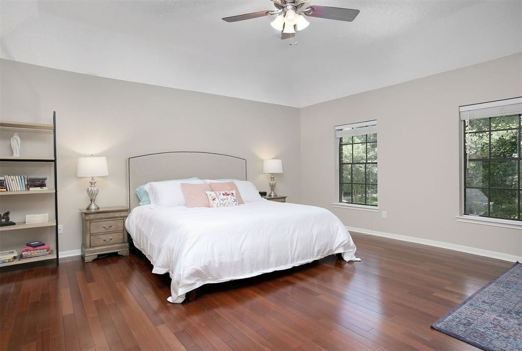 master bedroom gleaming hardwoods