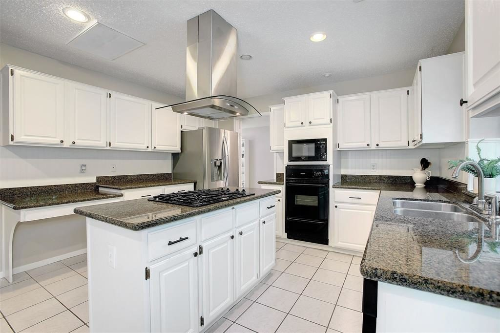 spacious kitchen with island granite counters