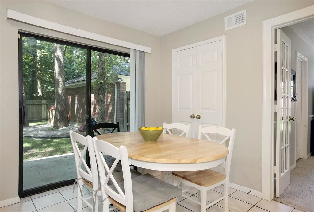 breakfast area in kitchen opens to patio